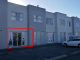 : Retail Unit with Garage Door - Retail For Lease